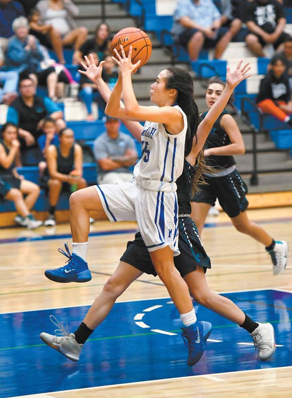 Maui High's Kristi Echiverri drives to the basket in the second quarter Wednesday.