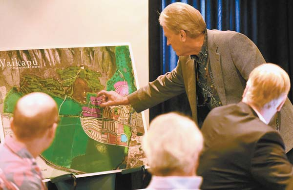Developer Mike Atherton shows state Land Use Commission members a feature on a map of his proposed Waikapu Country Town project Wednesday at the Maui Arts & Cultural Center. Plans call for building 1,000 single-family and 433 multifamily units. Also, as many as 146 ohana units would be allowed. The Maui News / MATTHEW THAYER photos