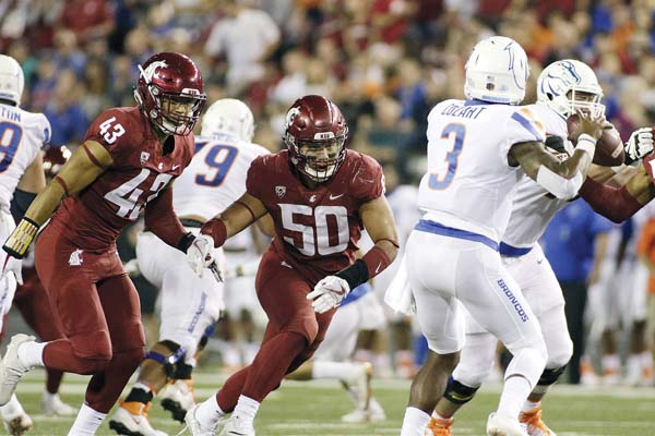 Hercules Mataafa (center), led the Pac-12 with 21.5 tackles for loss and 9.5 sacks this season for Washington State. AP file photo