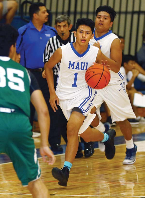 Maui High's Efren Villon dribbles toward Molokai's Keison Poaha Alcon while Scott Magno runs downcourt in the second quarter. - The Maui News / CHRIS SUGIDONO photo