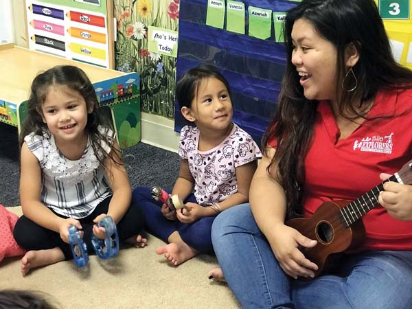 Makena Kotter (from left), Kamaile Eleneki-Alves and teacher Alia Nelson enjoy music time recently at Little Explorers Maui Preschool in Wailuku. A recent study shows that child care facilities for infants and toddlers are not keeping pace with demand. -- Little Explorers Maui Preschool photo