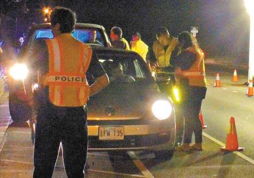 Baldwin High School students join police DUI Task Force officers at a DUI checkpoint in Kihei on Dec. 2. -- Maui Police Department photo