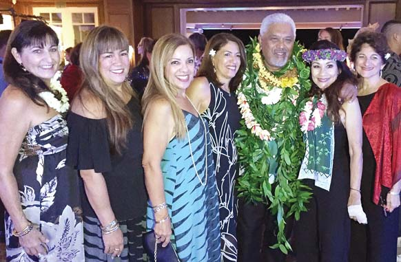 Clifford Nae'ole (with lei), the longtime cultural advisor of the Ritz, is surrounded by his St. Anthony school mates Charleen Parker (from left), Stacey Eaton, Esta Miller, Cindy Nobriga, April Santos and Cindy Collins. -- Photo courtesy April Santos