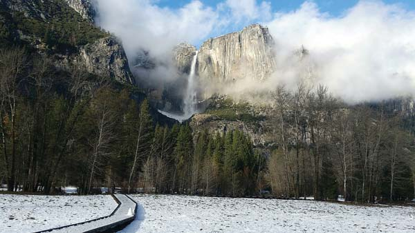 Yosemite Falls flows in Yosemite National Park in California in winter. The park is less crowded in winter and offers solitude, scenery and activities like hiking, snowshoeing, skiing and ice skating. -- AP photo
