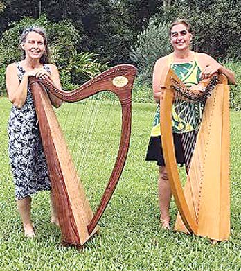 Lily Swan (left) and Crissy Palmieri will strum their harps at the Wailuku library from 6:30 to 7:30 p.m. Thursday.