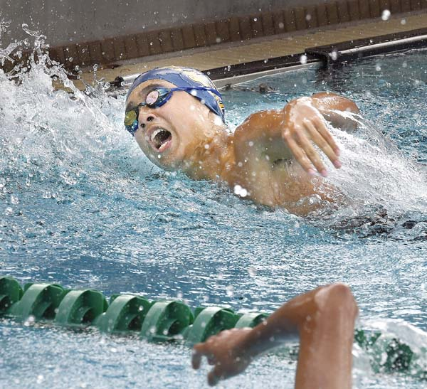 St Anthony's Sean Cerizo powers to the wall to win the boys 100 freestyle in 53.04. - The Maui News / MATTHEW THAYER photo
