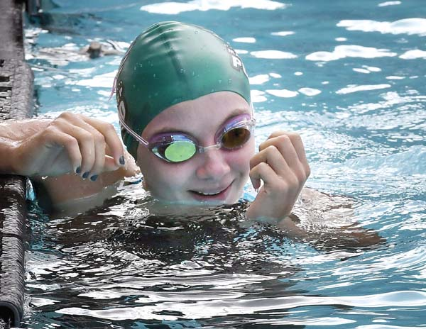 Maui Prep's Paloma Banto smiles after winning the girls 100 freestyle in 55.91 - The Maui News / MATTHEW THAYER photo