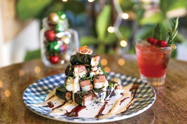 Rockin' Around the Musubi is a tree-like tower of mini Spam slices on rice garnished with dynamite sauce, tobiko and green onions. BLINNK PHOTOGRAPHY image