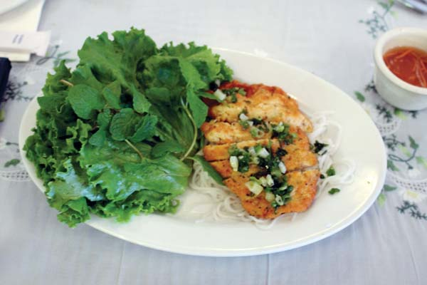 Shrimp pops are grilled on sugarcane sticks, sliced and rolled in lettuce leaves with fresh mint and cilantro.