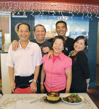 Longtime server Kiet Tran (from left) with chefs Taingu Yen, Ann Carpenter and Khanh Chau  and Carpenter's Oahu sister Sandy Nguyen. The Maui News / CARLA TRACY photos