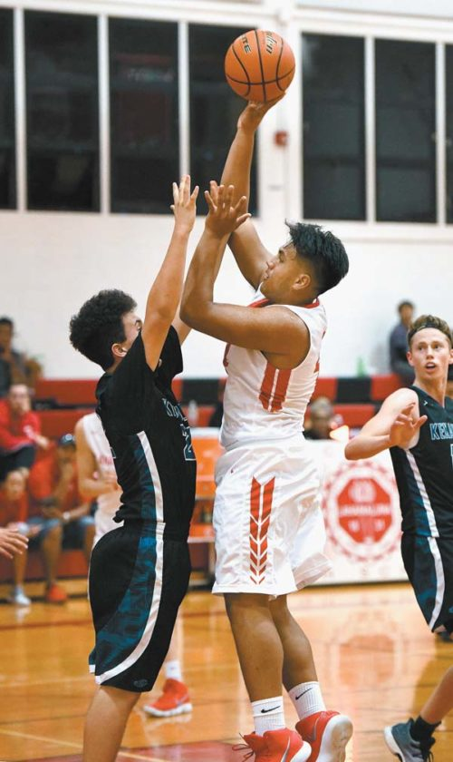 Lahainaluna High School's Koa Evalu-Robinson goes up for a shot as King Kekaulike's Kaleb Chun defends during the third quarter of the Lunas' 66-35 win over Na Alii on Wednesday. The Maui News / MATTHEW THAYER photo