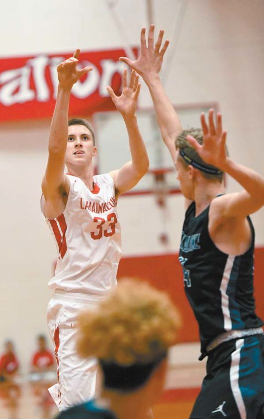 The Lunas' Carter Stockham follows through on a second-quarter shot in front of Na Alii's Dylan Baird.