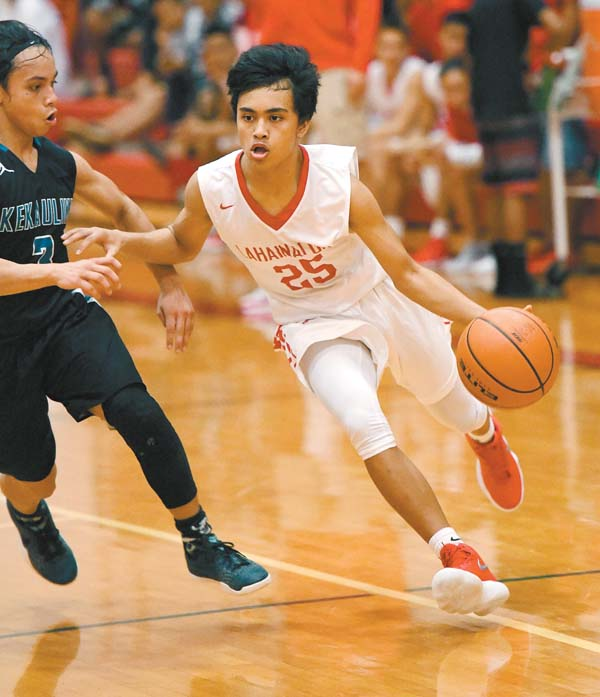 Lahainaluna's Tre Rickard drives in the second quarter as King Kekaulike's Ethan Bediamol defends.