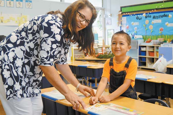 St. Anthony School kindergartner Colton Fahey celebrates with his teacher, Teri Tavares, recently at the school. The school is planning to open a second kindergarten class next year. St. Anthony School photo