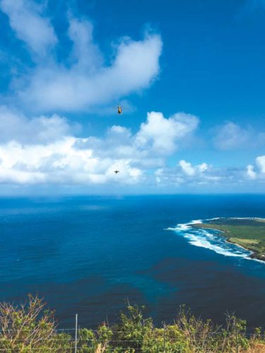 A person is airlifted from the Kalaupapa Trail on Molokai by the Maui Fire Department's Air One helicopter. Two people were injured Thursday morning on the trail when the mules they were riding collided. Maui Fire Department photo