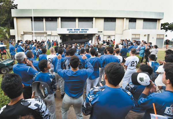 "As a crowd of Maui High School students, alumni, staff and supporters applauds, the name of the Izumi ""Shine"" Matsui Athletic Center is unveiled during dedication ceremonies Thursday afternoon at the Kahului campus. The Maui News / MATTHEW THAYER photos"