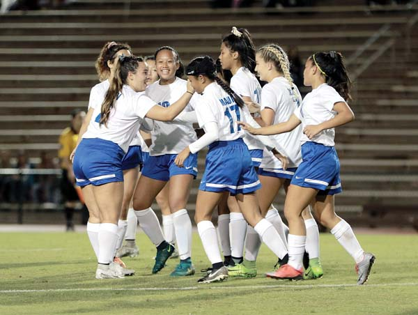 The Sabers celebrate a goal by Alibigec in the first half. -- The Maui News / CHRIS SUGIDONO photo