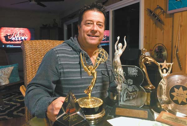 Ken Martinez Burgmaier with awards -- Photo courtesy 'Jazz Alley TV'