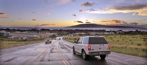Motorists make their way up and down the northern portion of the Lahaina bypass Friday as the sun sets over the neighbor island of Lanai. This bypass segment is mauka of the Lahaina Gateway Center and the intersection of Keawe Street and Honoapiilani Highway. -- The Maui News / MATTHEW THAYER photo