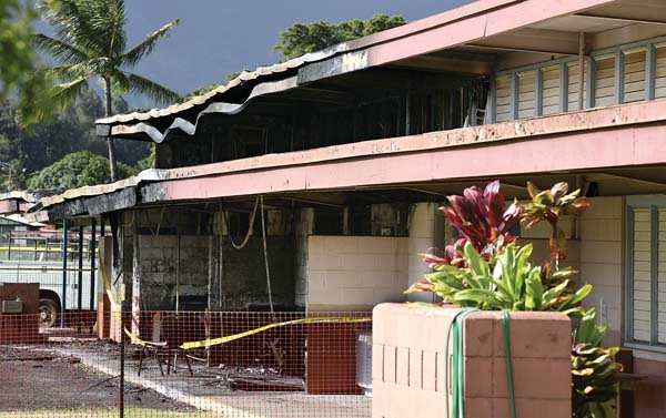 Yellow evidence tape surrounds a gutted classroom building Nov. 25 at Kahului Elementary School. A two-alarm fire destroyed at least three classrooms and severely damaged another Nov. 24. Police arrested a 17-year-old Kahului boy on Friday in connection with the fire that caused an estimated $1.2 million in damage. -- The Maui News / MATTHEW THAYER photo