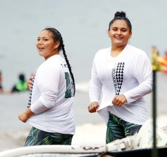 Talia Nakayama (left) and Shai Rawlins look at the scorer's table after helping Molokai's girls crew to a first-place finish. -- The Maui News / CHRIS SUGIDONO photo