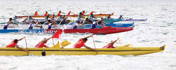 Crews in the mixed final take off from the starting line during Saturday's Maui Interscholastic League season-opening regatta at Ka Lae Pohaku. Kamehameha Maui won the race.  -- The Maui News / CHRIS SUGIDONO photo
