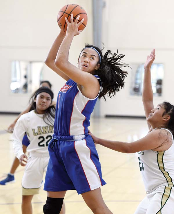 Seabury Hall's Anaulei Tuivai grabs a rebound in front of Lanai's Giyana Agliam during the second quarter of the Spartans' 36-34 victory over the Pine Lasses on Saturday. -- The Maui News / MATTHEW THAYER photo