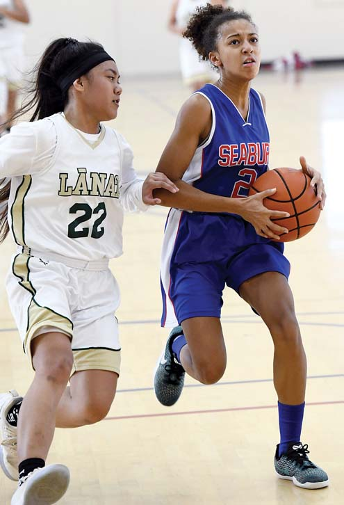 Ameera Waterford of the Spartans drives as the Pine Lasses' Kayla Garcia defends in the second quarter. -- The Maui News / MATTHEW THAYER photo