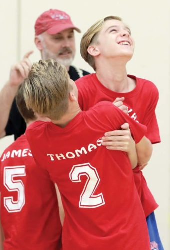 Thomas Russell of Seabury Hall I is picked up by his twin brother, Tyler, after scoring the final point of the first set of a 21-13, 21-9 win over Haleakala Walford in the Intermediate Middle School League boys/coed volleyball final Saturday at Erdman Athletic Center in Olinda. - The Maui News / CHRIS SUGIDONO photo