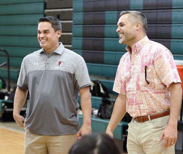 Brandyn and Jarinn Akana share a laugh during the King Kekaulike Tournament on Friday at Na Alii's gym. The brothers, who starred at Molokai High School, were on Maui as Brandyn Akana's Kahuku team played in the tournament. The Maui News / CHRIS SUGIDONO photo