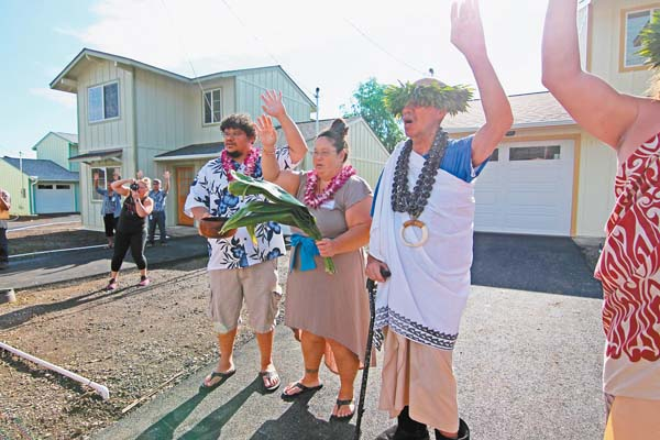 Joe Firsich (from left) and Wendi Kuon express their mahalo alongside kumu nui Kelii Taua in the driveway of their new home in Happy Valley on Monday morning. Nonprofit housing developer Lokahi Pacific held a blessing for its new Mokuhau Affordable Subdivision, a neighborhood of 16 single-family homes that are all going to first-time buyers. The Maui News / COLLEEN UECHI photo