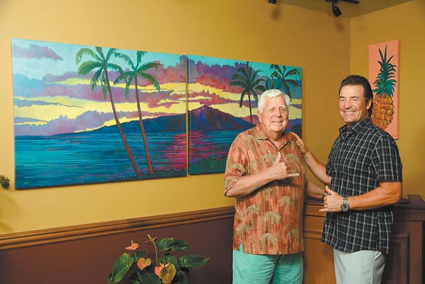 Wailea artist Ed Lane (at left) recently installed 15 new works at Sarento's on the Beach in Kihei. Owner Aaron Placourakis is pleased with the new look. The restaurant also entices with tiki torches, white tablecloths and ocean views. Sarento's photo