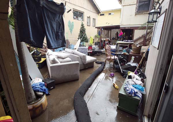 Furniture and other belongings are seen Thursday outside a Happy Valley residence that was heavily damaged by Wednesday's flooding. The Maui News / CHRIS SUGIDONO photo