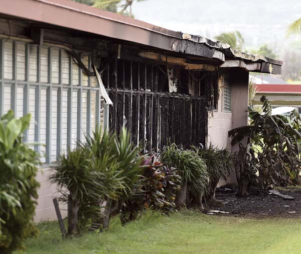 Blackened jalousie windows remain outside a classroom building Nov. 25 after a fire reported at 9:33 p.m. Nov. 24. The blaze left estimated structural damage of $900,000 and damage to contents of about $300,000. -- The Maui News  MATTHEW THAYER photo
