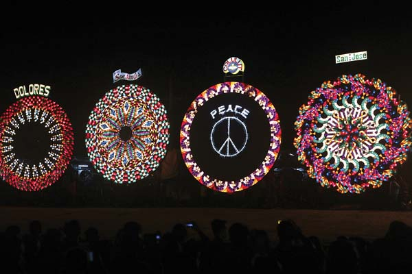Giant lanterns display their intricate light patterns at the competition in Pampanga province. -- AP photo