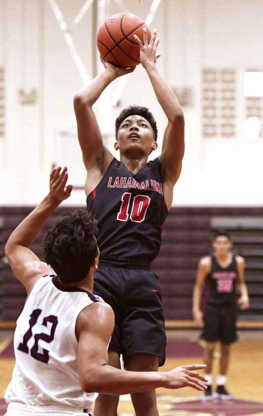 Lahainaluna High School's Reece Pascua goes up for a shot over Baldwin's Chayce Akaka during the first quarter of the Lunas' 64-38 victory over the Bears on Saturday at Jon Garcia Gym. - The Maui News / MATTHEW THAYER photo