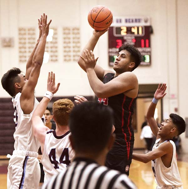 The Lunas' Koa Robinson finds room to shoot as the Bears' (from left) Kainalu Lacno, John Werner and Owen Nakamura defend. - The Maui News / MATTHEW THAYER photo
