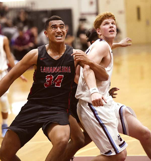 Lahainaluna's Siale Hafoka battles Werner battle for rebounding position. - The Maui News / MATTHEW THAYER photo
