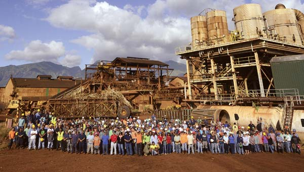 Hawaiian Commercial & Sugar Co. workers gather for a group photo at Puunene Mill on March 1, 2016, the day the final harvest of sugar cane began. - The Maui News / MATTHEW THAYER photo