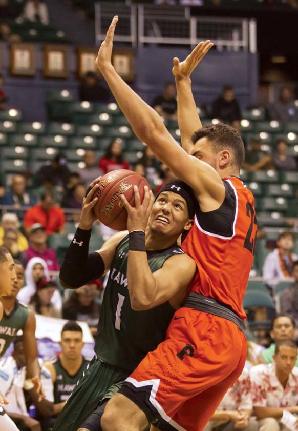 Hawaii's Drew Buggs is guarded by Princeton's Jerome Desrosiers during the second half of the Tigers' 77-63 win over the Rainbow Warriors on Monday in the Diamond Head Classic fifth-place game at the Stan Sheriff Center. AP photo