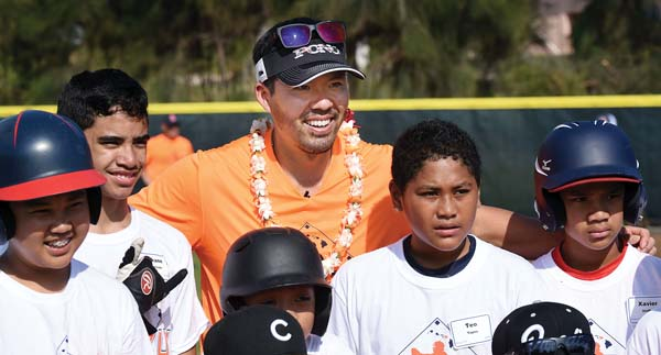 Maui-born major league baseball star Kurt Suzuki poses for a photo with participants in the All Pono Clinic that took place in January at Maehara Stadium in Wailuku. Suzuki and his wife, Renee, created the Kurt Suzuki Family Foundation, a 501(c)(3) nonprofit organization that aims to improve the lives of Hawaii residents by supporting medical research and promoting healthy lifestyle choices. The Maui News / MATTHEW THAYER photo