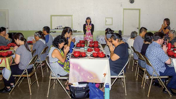 Those attending a Zen cooking class at the Kahului Jodo Mission on Dec. 10 give thanks for the food prepared for them. Teacher Naoko Moller said that Zen cooking is more than just cooking and eating the food; there are spiritual and social aspects as well. ASA ELLISON photos