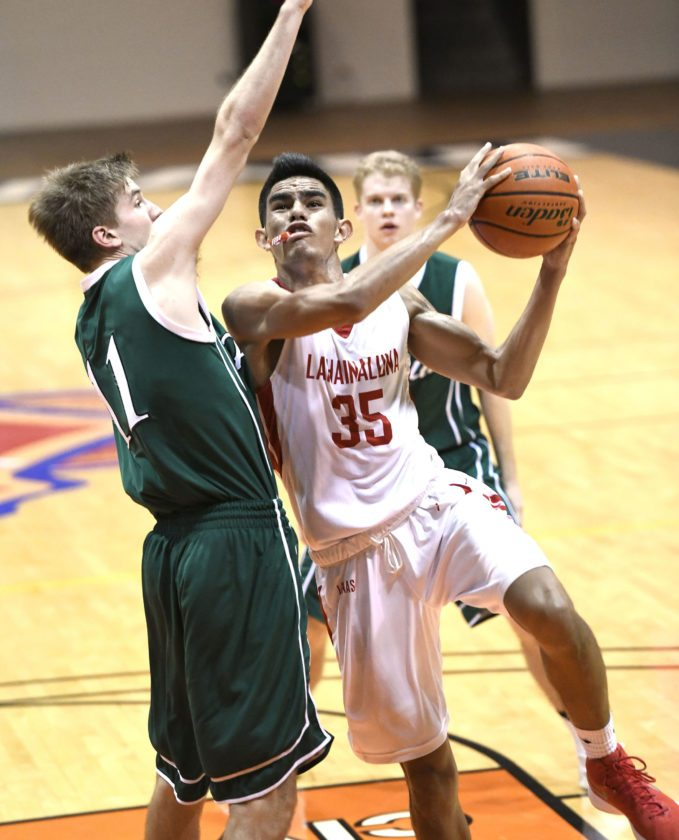 Lahainaluna's Aukai Kama drives to the basket against Palo Alto's Max Dotward in the second quarter Thursday.  • The Maui News / MATTHEW THAYER photo