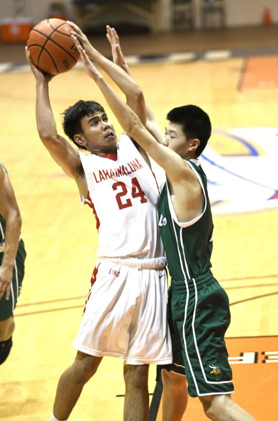 The Lunas' Iverson Turno is defended by the Vikings' Marvin Zou. • The Maui News / MATTHEW THAYER photo