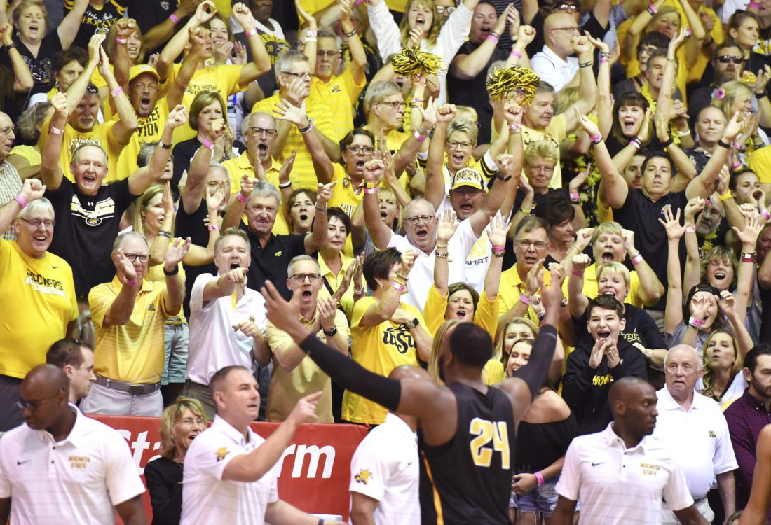 Wichita State basketball fans cheer their team during a win over Cal in this year's Maui Jim Maui Invitational at the Lahaina Civic Center in November. Boosters who made the trip from states like Kansas, Illinois, Michigan and Indiana helped elevate Maui's tourism numbers for the month of November. Maui visitor arrivals by air increased 9.3 percent in November to 215,266, compared with the same month last year, according to the Hawai'i Tourism Authority. • The Maui News MATTHEW THAYER photo