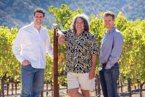 Brothers Jeff (left) and Mark Pisoni flank their famous dad Gary Pisoni in the family's Santa Lucia Highlands vineyards in California. -- Photo courtesy GARY PISONI