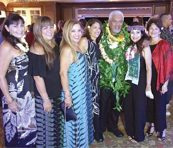 Clifford Nae'ole (with lei), the longtime cultural advisor of the Ritz, is surrounded by his St. Anthony school mates Charleen Parker (from left), Stacey Eaton, Esta Miller, Cindy Nobriga, April Santos and Cindy Collins -- Photo courtesy APRIL SANTOS