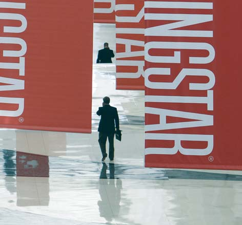 Attendees of a Morningstar investment conference walk beneath banners at the McCormick Center in Chicago on June 24, 2010. Understanding mutual fund share classes could save investors hundreds of thousands of dollars over the long term. -- AP file photo