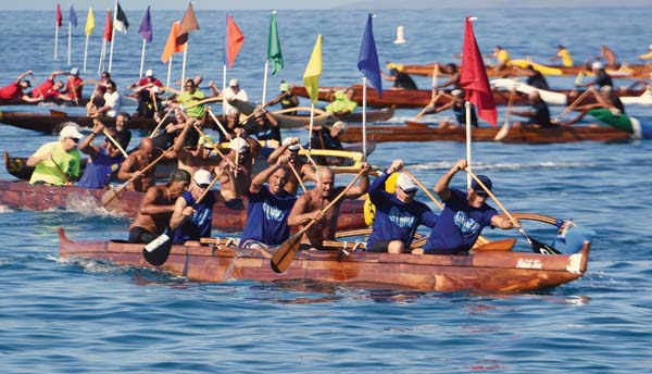 The Hawaiian Canoe Club men's 60 crew leads the way out of the turn on its way to taking first place at the state regatta, helping the club run its streak of Hawaiian Canoe Racing Association titles to five. -- The Maui News / MATTHEW THAYER photo