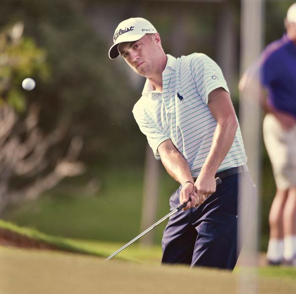 Justin Thomas chips during the Tournament of Champions. -- The Maui News / MATTHEW THAYER photo